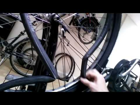 How to fix a flat bicycle tire keeping wheel on