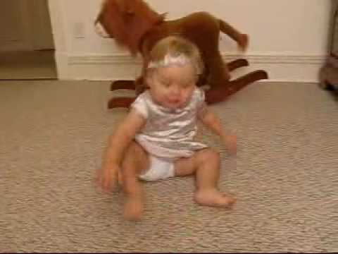 Toddler learning to stand and walk