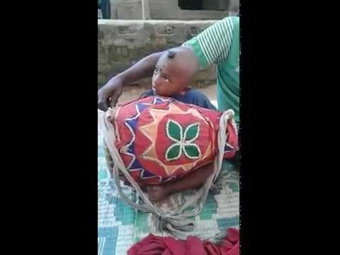 Funny baby use musical instruments in india