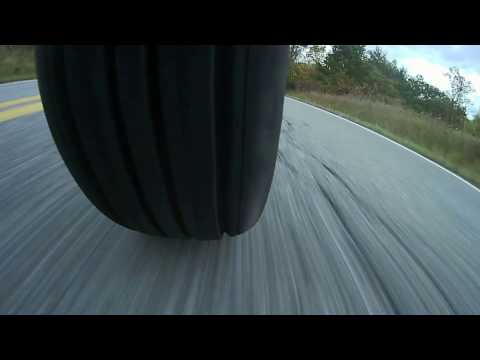 Double Darksided (Car tire on front and rear of a motorcycle)