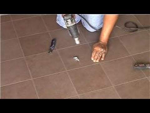 Vinyl Flooring Maintenance & Cleaning : How to Repair a Bubble in a Vinyl Kitchen Floor