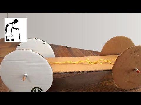 A simple Rubber Band Powered Car - Cardboard, 2 pencils, 5 paperclips