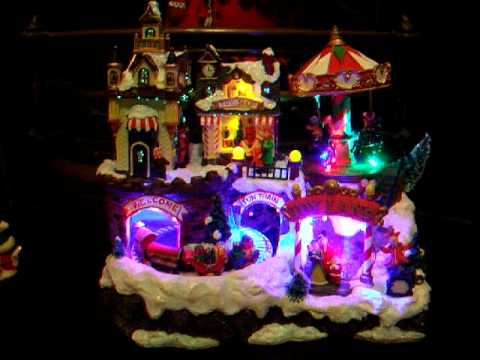 Illuminated Animated Christmas Village With Train And Carousel