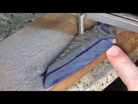 Creating a knife bevel with a file jig.