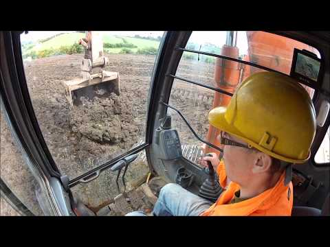 Operating a Hitachi 130 excavator