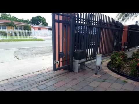 Sliding gate garage door opener residential