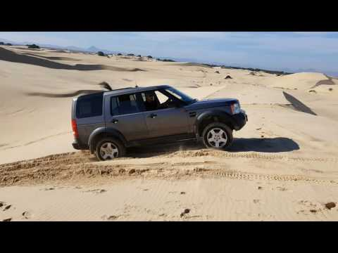 Land Rover Discovery 3 driving in sand dunes