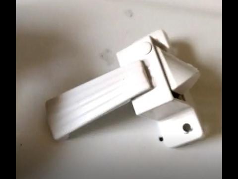 Remove lock from storm or screen door latch handle
