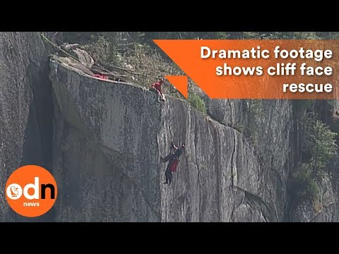 Dramatic footage shows man rescued from 350m cliff face