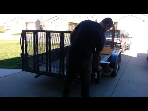 Folding trailer ramp and tailgate