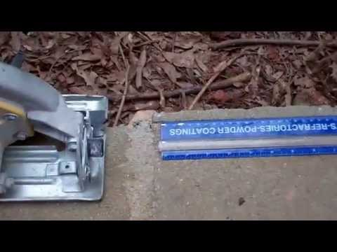 Cutting a Concrete Block on a Retaining Wall