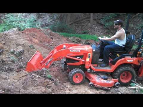 Part 2 building ATV jumps with Kubota BX25D