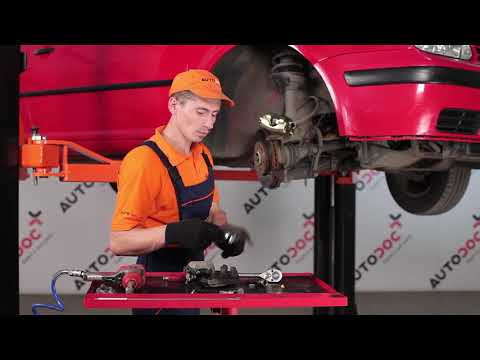 How to replace a front brake caliper on VW GOLF 4 TUTORIAL | AUTODOC