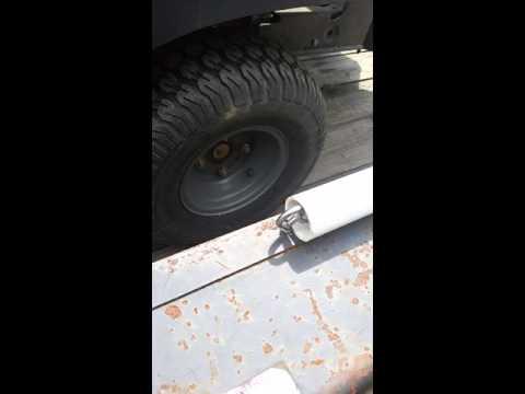 Trailer assist lift gate