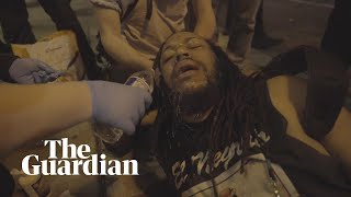 African American film-maker is pepper-sprayed then engages protest police in conversation