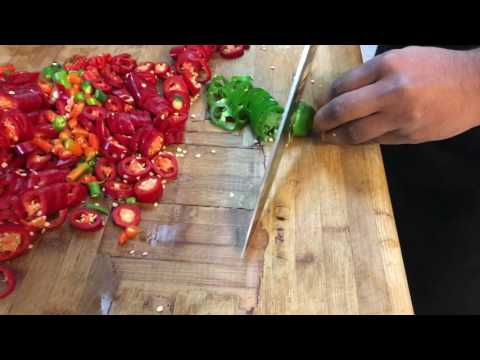Cutting spicy peppers & chili at los cabos tex mex grill