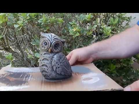 Painting a concrete statue to look like aged stone.