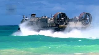 US Navy LCAC Hovercraft Land on Beach, Unload Equipment, Return to Aircraft Carrier
