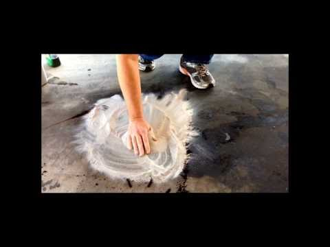 How to clean Oil slicks in a parking lot.
