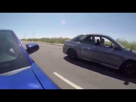 400hp E-85 Evo takes on Bolt-On Tuned 5.0 Mustang in the streets!!