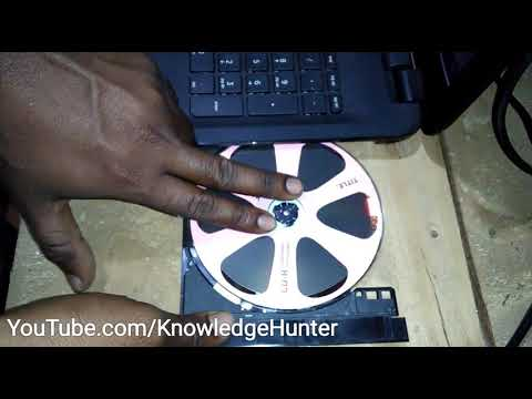 How to insert CD into HP Laptop computer