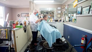 Michigan barber reopens despite governor's orders
