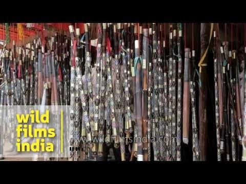 Traditional Rajasthani wooden staffs sold at Pushkar mela, India