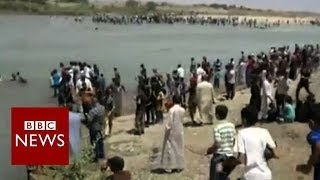 Iraqis attempt river crossing as militants take Mosul - BBC News