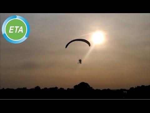 Paravelo flying bicycle landing at dusk