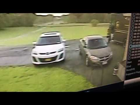 UPS driver flying into my beat up driveway