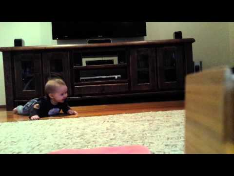 Baby laughing learning to crawl