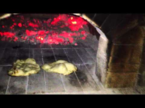 Making naan in wood fired oven