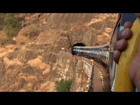 Goa express going up Braganza ghat section through Dudhsagar falls.