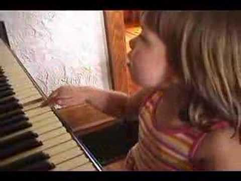 Sydney playing the piano & singing