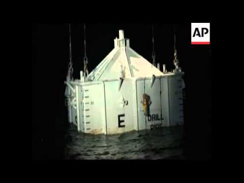 Containment unit lowered into Gulf in attempt to divert oil spill