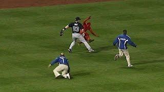 Diaz helps security apprehend fan on field