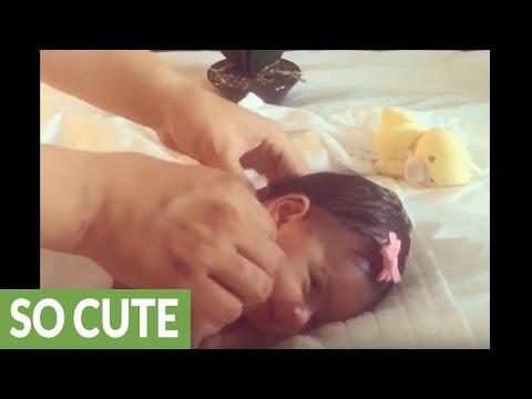 Newborn baby enjoys relaxing massage