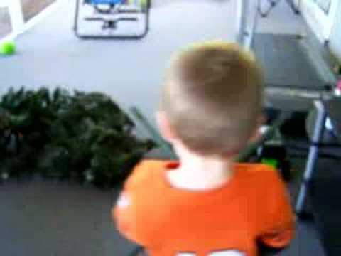 dylan with christmas tree stand