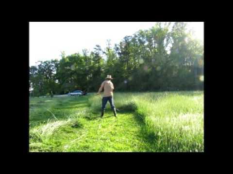 Cutting hay with a scythe at Cedar Creek Farm 2