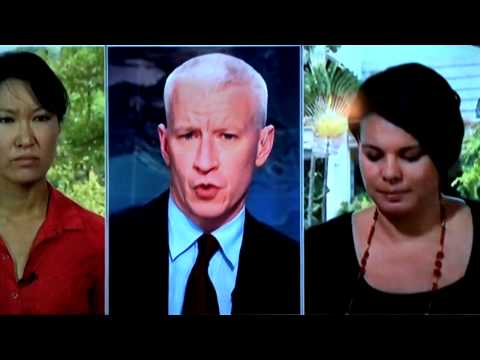 CNN's Sarah Sidner wiping tears from face during interview about Malaysian Air 370
