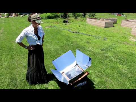 COOKING 2 CHICKENS AT THE SAME TIME ON A SUN OVEN AND 300 BALES OF HAY