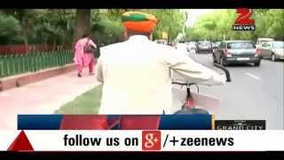 Download BJP MP Arjun Ram Meghwal reaches Parliament on bicycle Video