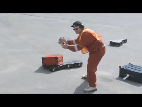 Baggage Handlers Caught on Tape Damaging Luggage