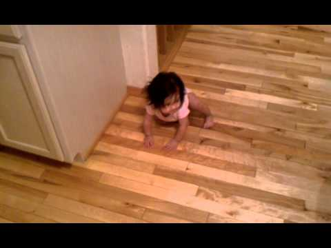 Babies first crawl on hardwood.