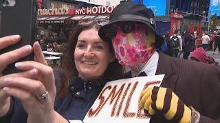 Masked 'Doctor' Gives $100 Bills to Total Strangers