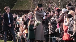 Watch Princess Charlotte refuse to let go of her flowers. Royal Family Attend Christmas Day Service