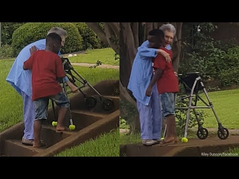 8-year-old helps elderly woman up the stairs in random act of kindness