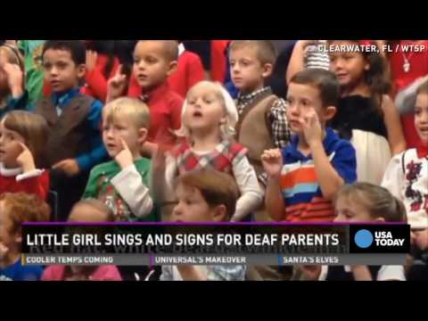 Girl signs Christmas concert for deaf parents