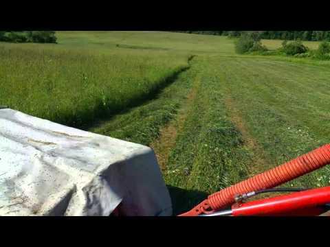 John Deere mowing hay Kuhn disc mower