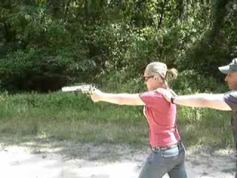 Chick almost shoots herself!!!